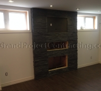 Basement Finishing with Stone Fireplace