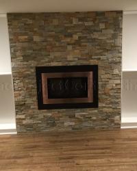 Stone wall around the fireplace