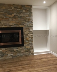 Stone wall and custom build in around the fireplace