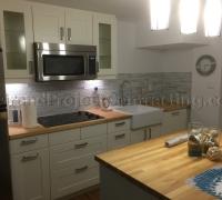 Basement Kitchen with Glass Backsplash Tiles